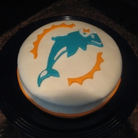 Miami Dolphins Birthday Cake My first cake using fondant and decorating in general. I made marshmallow fondant. Vanilla cake with vanilla buttercream and fruit filling...
