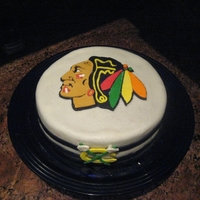 Chicago Blackhawks Birthday Cake My second fondant cake made for my boyfriend's birthday in 2012. Used MMF, coconut cake and chocolate ganache instead of buttercream...