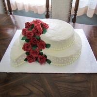Wedding Cake   paisley shaped carrot cake with cream cheese icing, fondant/gumpaste roses
