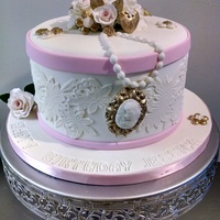 Vintage Fondant Birthday Cake. This is a carrot cake fill with cream cheese filling cover in fondant. Decorated with hand crafted roses, gold leaves, beautiful lace and a...