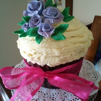 Giant Cupcake Giant cupcake with sugarpaste violets, buttercream in a chocolate moulded pattypan.