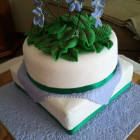Violet Anniversary I created this two tiered cake featuring gumpaste violets for my parent's 40th Wedding Anniversary. I am quite new to cake decorating...