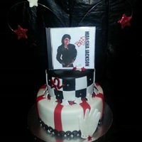 Micheal Jackson Wanna Be!!! This cake was for a friend that loves MJ. I had my graphic guy make the CD over. It has her face and says Marsha Jackson. The Glove is...