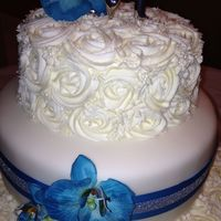 "White Rosettes And Blue Saigon Orchids Top and bottom tiers are buttercream rosettes. Middle is covered in fondant. The bride hand dyed the orchids. The cakes are 16"", 12&..."