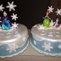 "Disney's Frozen ""Frozen"" cakesGum paste snowflakes, fondant covered. Girls & Olfa are dolls."