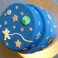 Ollie's Space Cake   My very first attempt at a cake. I used white fondant icing and coloured it myself. Fondant cut-outs and disco dust stars.