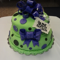 Green And Purple Baby Shower Cake  This is a cake I made for a friend's upcoming baby shower. It was a red velvet cake with cream cheese. I covered the cake in lime...