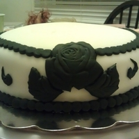 "Black And White Damask Cake  This is a cake that I made for my brother and his wife to cut at their wedding. Their theme was black and white. I did an 8"" round..."