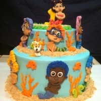 Bubble Guppy Cake Fondant Guppies with Custom Guppy topper to look like birthday girl.