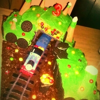 Thomas Chocolate Skittle Forest Come join thomas on his journey through the river of chocolat. Chocolaty fudge flavored cake, covered in butter creme. Embellished with...