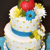 Rustic Love Buttercream with colorful flowers and carved apple.