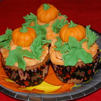 Pumpkin Patch Cuppy Cakes Fondant Pumpkins Buttercream Icing Pumpkin Patch Cuppy Cakes! Fondant pumpkins, buttercream Icing.