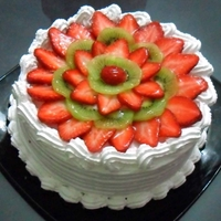 Strawberry-Kiwi Cream Cake Vanilla cake filled & topped with strawberries, kiwi & cream. I would love to improve my work so please give me all the feedback...