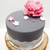 Birthday Cake Grey dove with dusky pink open peony flower centre with beruina berries. Rustic string and wooden cake slab finishes the cake off nicely.
