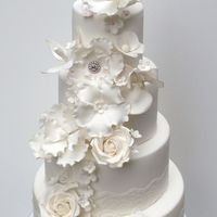 White Elegant Wedding Cake With Sugar Flowers Magnolia Orchid Roses Blossoms Hydrangeas White elegant wedding cake with sugar flowers magnolia, orchid, roses, blossoms, hydrangeas