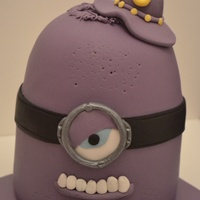 Despicable Me Minions Chocolate mud cake with 4 layers of chocolate ganache.