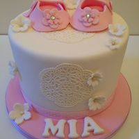 Christening Cake This was my first christening cake order. I absolutely loved this cake. I hand modelled the little pink booties. Used original sugarveil...