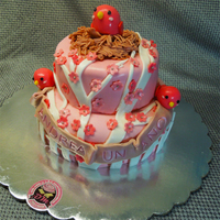 Pink Birds Nest This cake is a series of three decorated cakes for a sweet table. The idea was to put the mother on her nest, two young children to the...