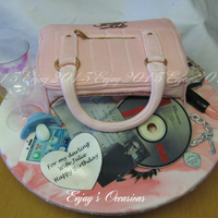 Hand Bag And Accessories Cake A lemon sponge filled with buttercream and lemon curd, all the items are edible, apart from the plastic glass. the cd is actual size and...