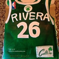Boston Celtic Jersey Cake customer. It is Boston Celtic theme jersey. It contains the the age and last name of the persons birthday!!!