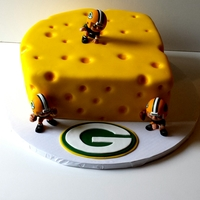 "Green Bay Packers "" Cheese "" Cake This was made as a groom's cake. German chocolate cake with chocolate mousse filling."