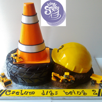 Construction Dump Truck Cake This is an Icing Smiles cake that I made for a little boy that likes construction and dump trucks :)