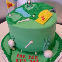 Golf Themed Birthday Cake 3 Layer 10 in rounds Vanilla Cake with Fresh Strawberry Mousse Filling Frosted in Buttercream with Fondant Frog..who caught a ball in his...