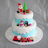 Winter Wonderland Christmas Cake Winter themed christmas cake complete with a jolly snowman, happy penguin, plum pudding, santa and his sack, candy canes, and a train full...