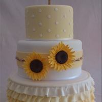 Wedding Cake With Sugar Sunflowers And Ombre Ruffles *A country/rustic themed wedding cake with sugar sunflowers and yellow ombre ruffles.