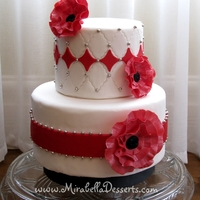 Simple Red And White Cake With Fantasy Ruffle Flowers Simple red and white cake with fantasy ruffle flowers.