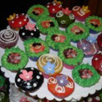 Hippie Birthday Party Various Flavours of Cupcakes, covered in a variety of colours and designs