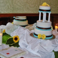 Parent's Wedding Cake   Alternating layers of chocolate and vanilla cake with strawberry filling/yellow gerbera daisies