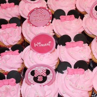 Minnie Mouse Cupcakes! Minnie Mouse Cupcakes with fondant ears, bows and pearl sprinkles!