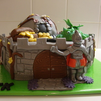 "Castle With Knight, Dragon And Treasure.... I made the Knight en dragon from the book from ""Debbie Brown - Enchanting Magical Cakes"""