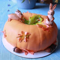 Pumpkin And Bunnies Cake made of two bundt pans put together, frosted with chocolate frosting. Covered in fondant. Used cotton string to make lines for pumpkin...