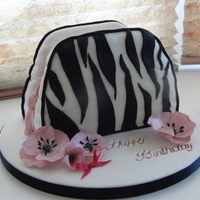 Kim's Birthday Cake this is a small make-up bag.My brush and comb were rubbish so I made it as if the zip was done up. Phew! It is made from 1 eight inch squre...