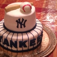New York Yankees I used marshmallow fondant to cover the entire cake and dyed the fondant for all the accessories and letters
