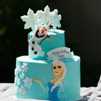"Frozen ""Frozen"" Inspired Cake. Two tier vanilla cake iced and filled with buttercream. Elsa and Olaf were handpainted on fondant with..."