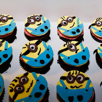 Minion Birthday Cupcakescute And Fun To Make The Cupcakes Are Chocolate With Raspberry Buttercream Filling And Icing Minion Birthday cupcakes...cute and fun to make. The cupcakes are chocolate with raspberry buttercream filling and icing .