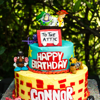 Toy Story Inspired Cake The Toy Story cake is done and delivered....I had so much fun doing this cake; I really enjoy modelling characters out of sugar. My client...