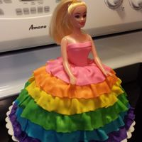Rainbow Barbie Barbie with rainbow fondant gown over butter cream frosting.