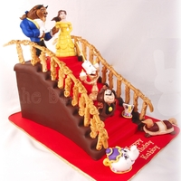 Beauty And The Beast Staircase Cake This cake was commissioned by a guy who wanted to give his Beauty and the Beast-loving girlfriend an epic cake for her birthday. Cake is...