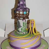 Tangled Rapunzel & Tower Birthday Cake  A Tangled Rapunzel & Tower Birthday Cake made from a Jam & Buttercream Victoria Sponge.Using (my first time!) RKT for the Tower...