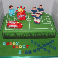 Football Pitch Character Cake Football Pitch with Football Team and Childrens Characters Team. Jam and Buttercream Victoria Sponge with sugarpaste coverings and models....