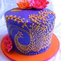 Mehndi Peacock Cake This cake was made for an art teacher who loves color. Lemon cake , filled with cream cheese icing, and frosted with vanilla buttercream....