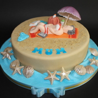 Beach Themed Birthday Cake coloured caster sugar used for sand. Parasol made from flowerpaste and then airbrushed