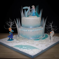 Frozen Themed Cake Used my son's Disney infinity characters on this cake, but Olaf was hand made by myself :). The top tier was a dummy cake as she...