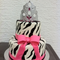 Zebra Princess Cake is covered in MM fondant, zebra pattern was painted on. Tiara is made out of Gumpaste.