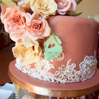 Brown Wedding Cake With Ivory Roses Brown wedding cake with ivory roses