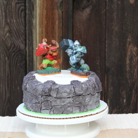 Skylanders Cake - Portal Of Power - Buttercream With Mmf Top   The finished cake with a couple Skylanders added. Cake done in buttercream with MMF topper.